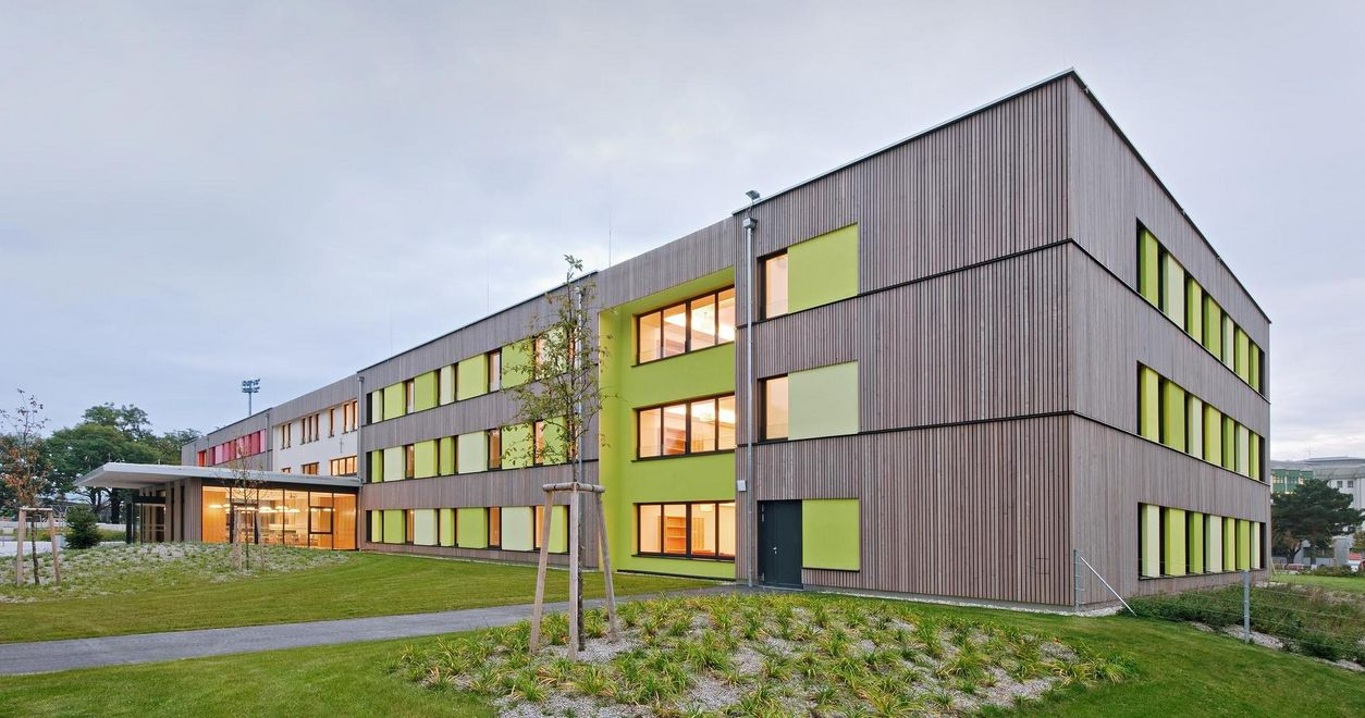 Photo: Horn Care Home: Exterior view of the three-storey building with wooden facade, with green area in front